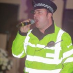 Marcus As Singing Policeman